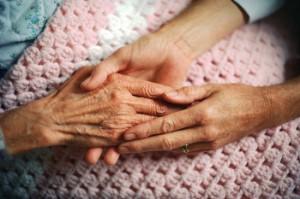 caregiver holding hand