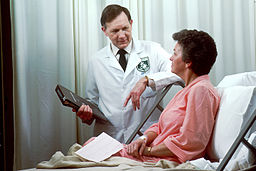doctor consults with patient